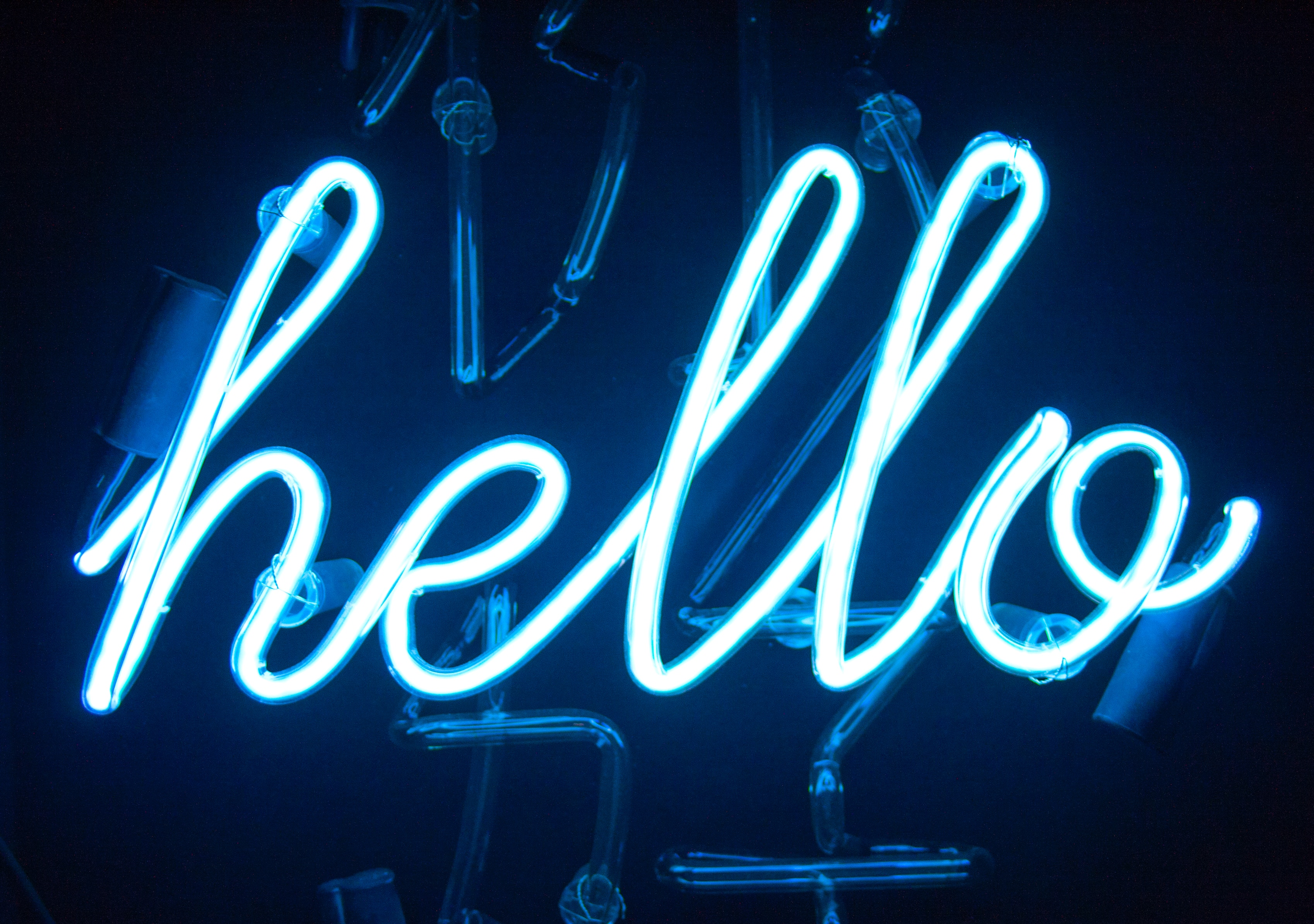 A neon blue sign that says hello.