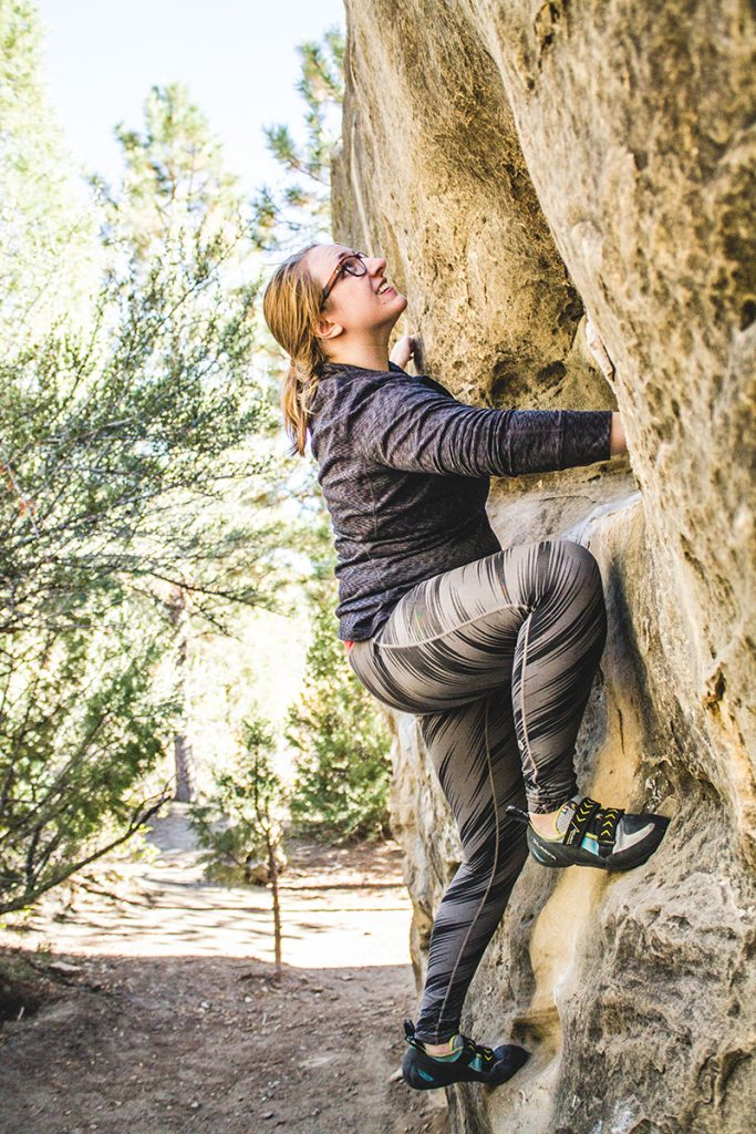 A woman bouldering