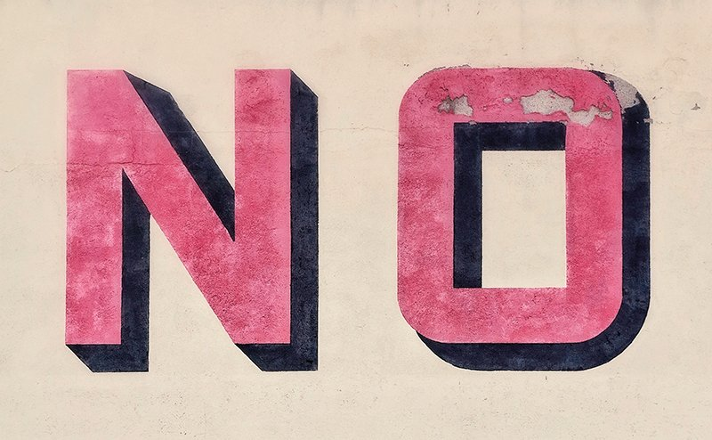 The word no painted on a wall.