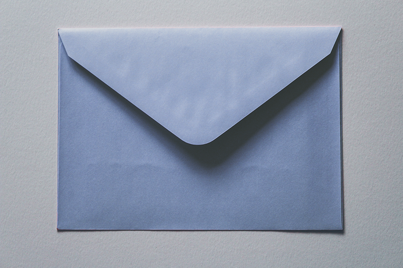 A blue envelope that is unsealed.